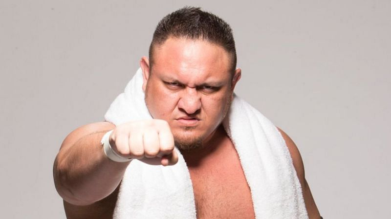 Samoa Joe is seen entering with a white towel around his neck