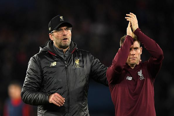 Milner and Klopp applaud the travelling Reds at full-time