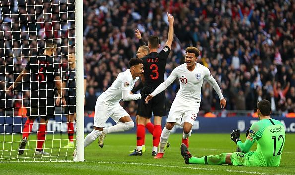 Lingard wheels away to celebrate a timely equaliser for England