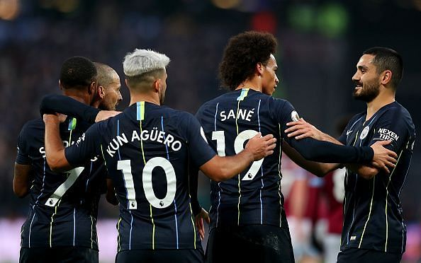 Manchester City players celebrate during their 4-0 thrashing of West Ham