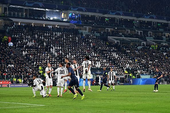 Mata watches on as his sweetly-struck effort flies over the Juventus wall goalwards