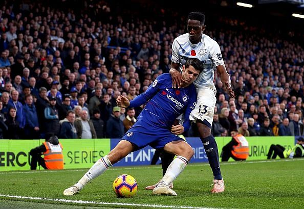Alvaro Morata (left) tussling with Everton defender Yerry Mina (in white) during their Premier League clash at Stamford Bridge