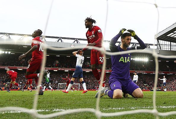 Lloris in disbelief after fumbling Salah's headed effort, watching it trickle and bounce off Alderweireld in