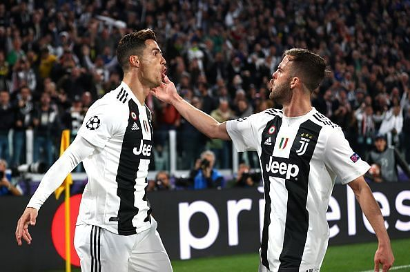 Ronaldo celebrating his opener with Miralem Pjanic, whose cross was duly converted by the Portuguese