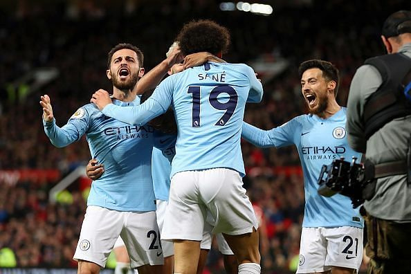 Bernardo, Sane and David Silva celebrate during City's 2-0 win over their neighbours