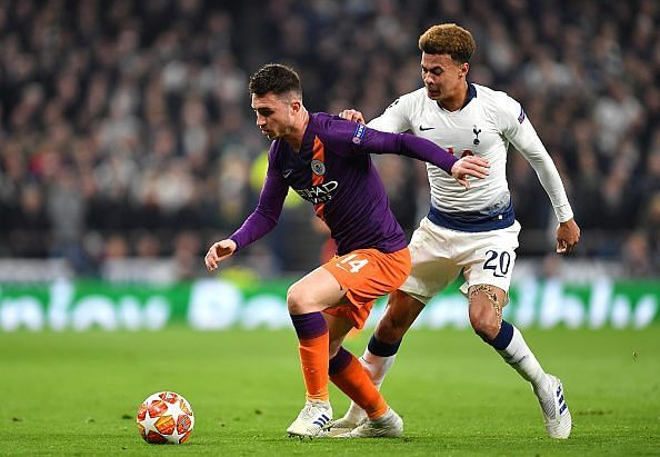 Laporte in possession with Alli lurking behind as Spurs adopted a successful pressing approach