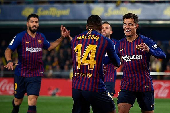 Malcom celebrates with Coutinho after creating his second La Liga assist in as many games early on