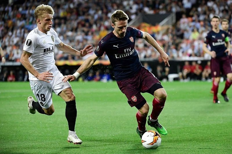 Monreal, during a duel for possession with Valencia's Daniel Wass