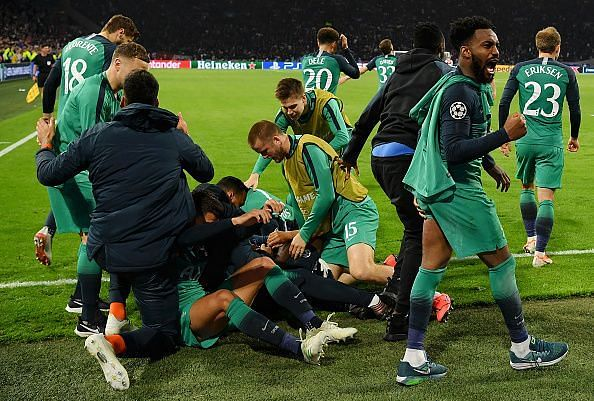 Tottenham players mob Lucas Moura as he completed his hat-trick in the dying embers of stoppage-time