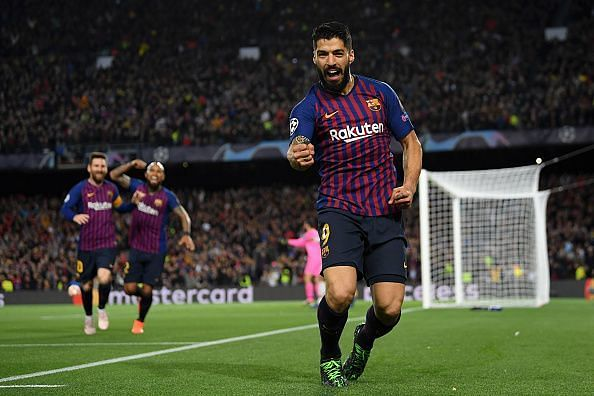 Suarez wheels away to celebrate his composed finish against his former side midway through the first-half