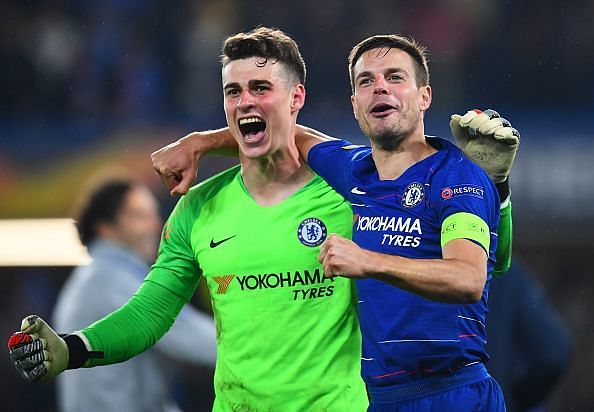 Penalty hero Kepa Arrizabalaga celebrates with captain Cesar Azpilicueta after a late finish at the Bridge