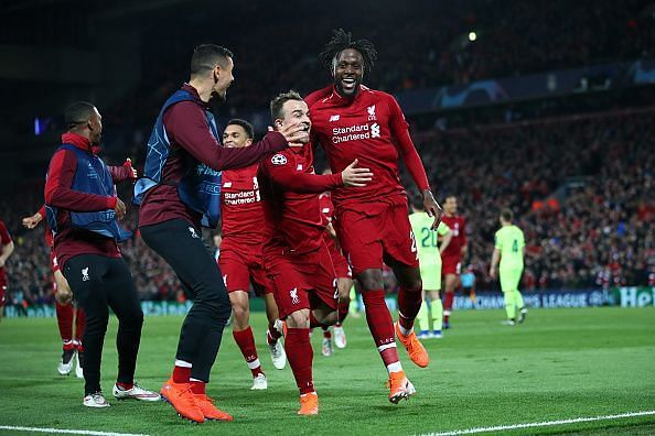 Origi wheels away to celebrate his winning goal with teammates as Liverpool stunned Barca 4-0