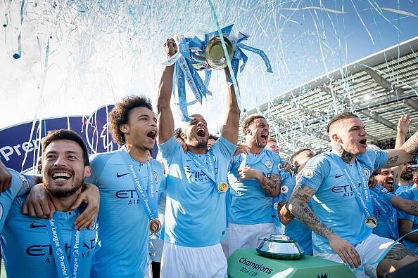Manchester City players celebrate with the Premier League trophy after finishing the season on 98 points