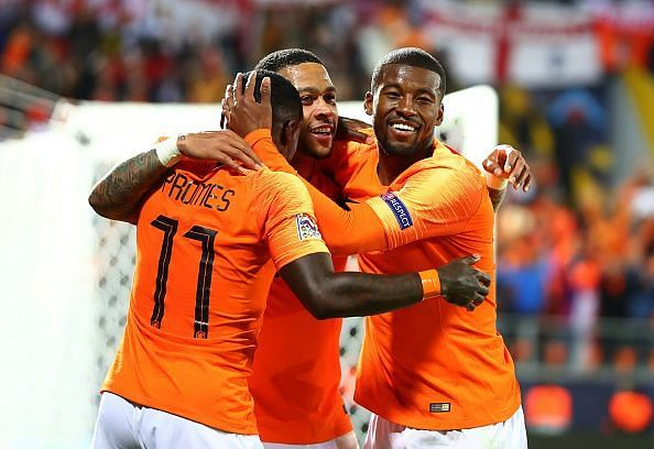 Memphis Depay, Georginio Wijnaldum and super sub Quincy Promes (far left) celebrate during their SF win
