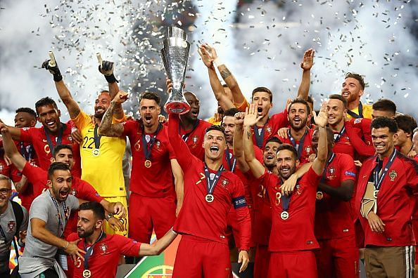 Portugal captain Cristiano Ronaldo lifts the Nations League trophy aloft after their 1-0 win over Holland