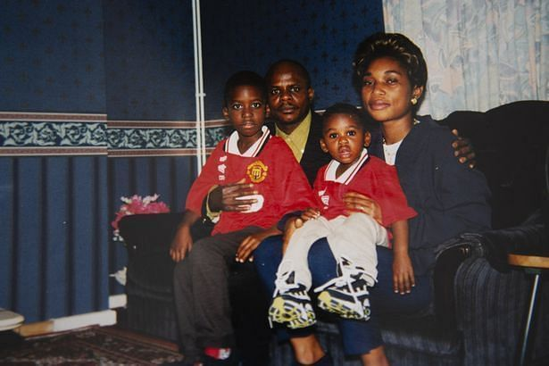 A picture of young Aaron (sitting on his mum's lap) wearing Man Utd red has been doing the rounds recently