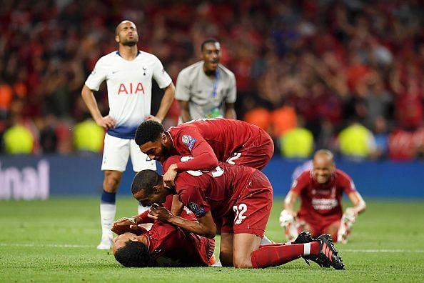 van Dijk, Matip and Gomez celebrate at the full-time whistle after Liverpool's Champions League Final win
