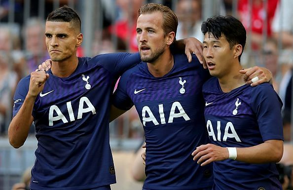 Harry Kane celebrates with Lamela and Son after opening the scoring in their Audi Cup semi-final win