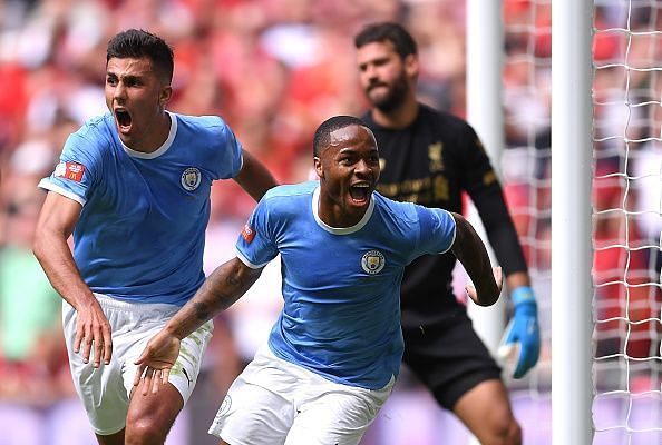 Sterling wheels away to celebrate his goal with Rodri - his first in 11 appearances against Liverpool