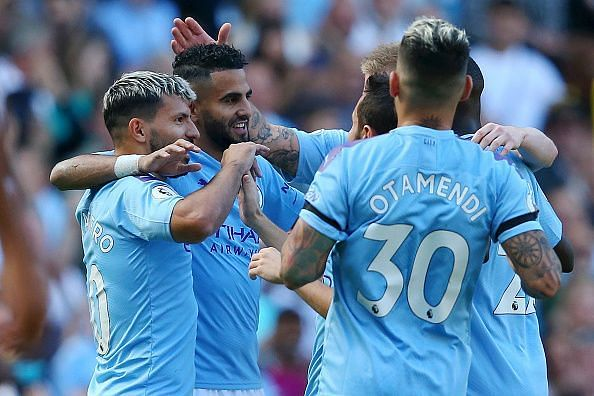 Mahrez celebrates his strike with teammates during a memorable home victory