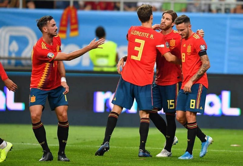 Spain players celebrate with captain Ramos after breaking the deadlock on the half-hour mark from the spot