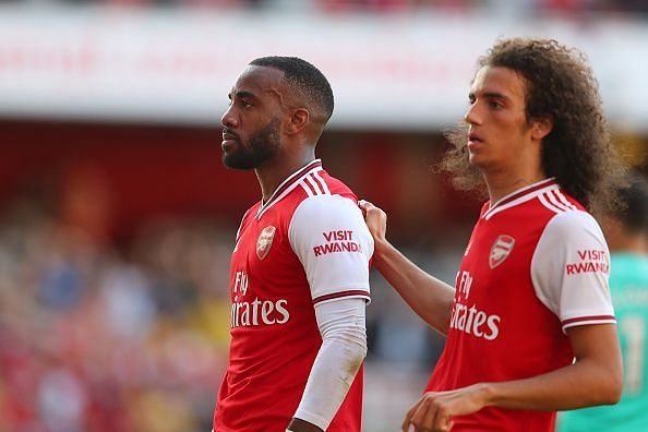 Lacazette and Guendouzi with a muted celebration after the former halved the deficit before half-time