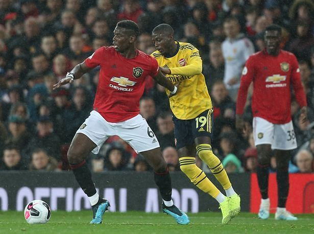 Pepe in pursuit of Paul Pogba on another frustrating evening's work for the Ivorian winger