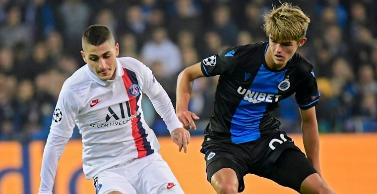 Ketelaere battling with PSG's Marco Verratti on a memorable night for the 18-year-old