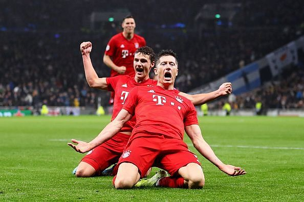 Lewandowski celebrates his razor-sharp finish with Benjamin Pavard and Niklas Sule behind him