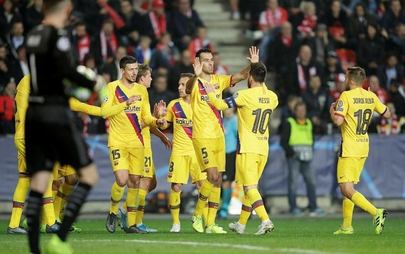 Barca players celebrate with Messi after his early opener during their 2-1 win over Slavia Prague