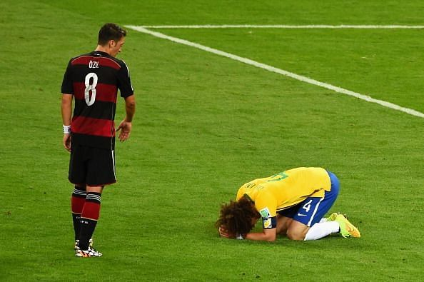 David Luiz crying on the pitch after Brazil was humiliated in the 2014 FIFA World Cup