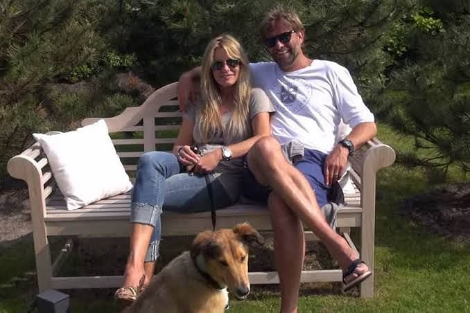 Klopp in a park with his wife and dog