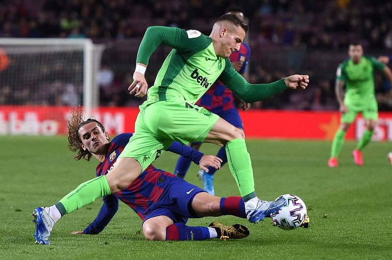Tarin attempts to skip past Griezmann during a difficult evening's work for the visitors