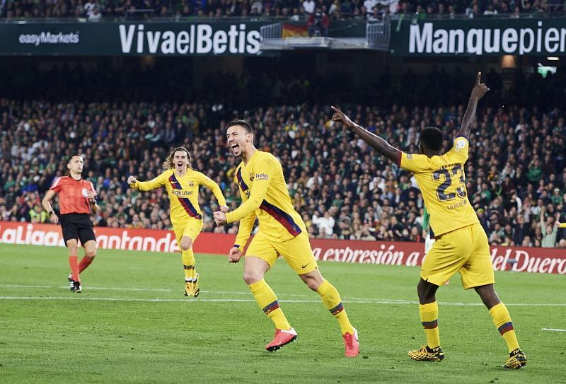 Clement Lenglet wheels away to celebrate his brilliant header - sealing all 3 points for Barcelona at Betis