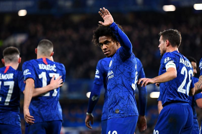 Willian celebrates his opener as Chelsea were victorious over Liverpool to book their FA Cup QF place