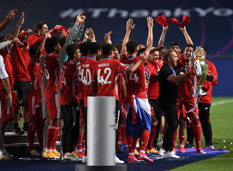Hansi Flick - initially viewed as a temporary fix - celebrates with the Bayern players after their UCL win
