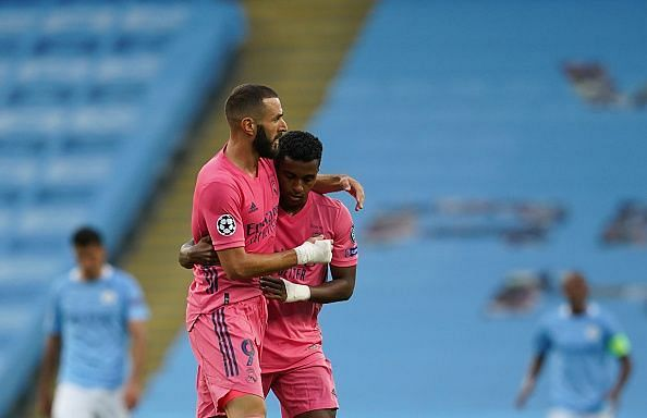 Benzema celebrates his strike with Rodrygo, who left Cancelo for dead before fizzing in the cross