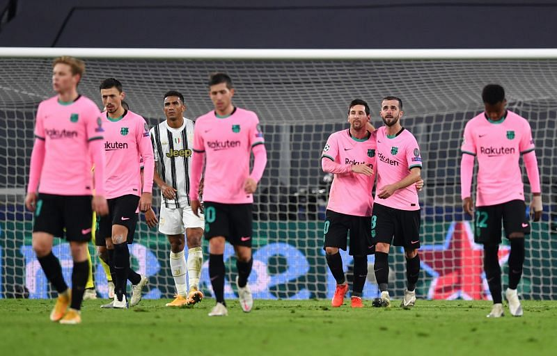 Barcelona players celebrate after Messi's penalty helped seal all three points against an under-fire Juventus