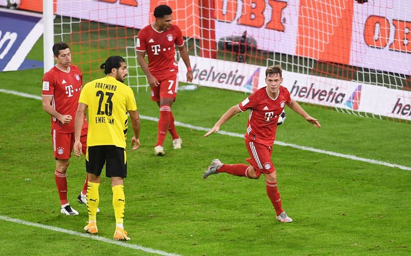 Kimmich wheels away to celebrate a well-taken winner late on against a wasteful Borussia Dortmund
