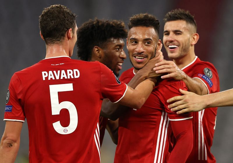 Bayern players celebrate Tolisso's sumptuous strike to extend their second-half advantage against Atletico