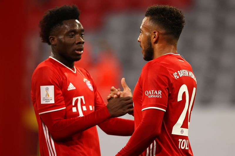 Davies celebrates with Tolisso after a lightning counter-attack was finished during an eventful first-half