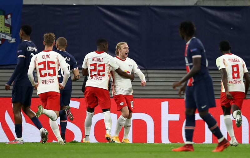 RB Leipzig players celebrate after Emil Forsberg's second-half penalty against PSG