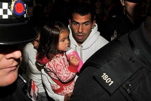 Carlos Tevez arrives back at Manchester airport earlier this month