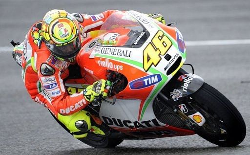 Rossi finally shines in Spanish rain