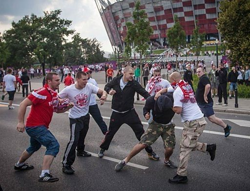 Russian police detain football fan with Nazi flag