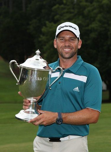 Sergio Garcia of Spain holds the Sam Snead Cup after winning the Wyndham Championship