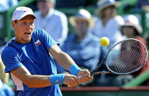 Czech Republic's tennis player Tomas Berdych returns the ball to Argentina's Carlos Berlocq