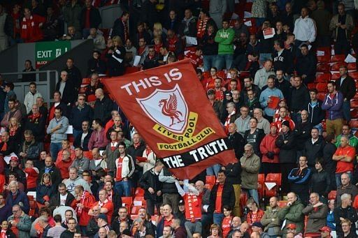 A banner praising the findings of a recent report into the Hillsborough disaster is unfurled by Liverpool supporters