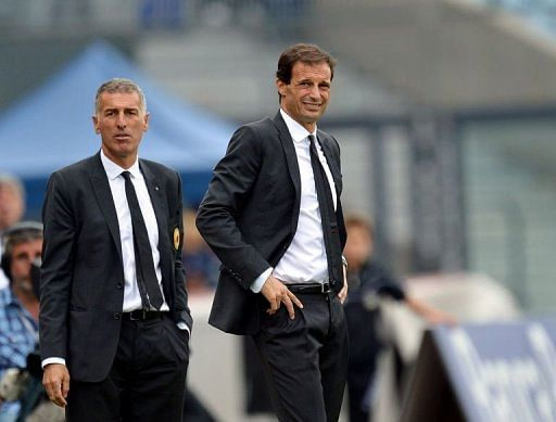 AC Milan's coach Massimiliano Allegri (R) grimaces next to his assistant Mauro Tassotti