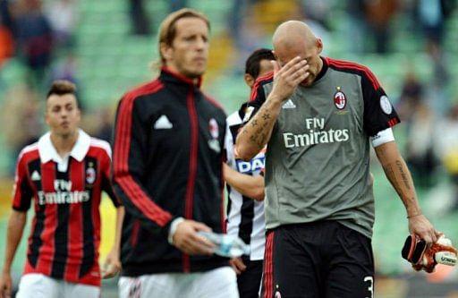AC Milan's goalkeeper Christian Abbiati (R)